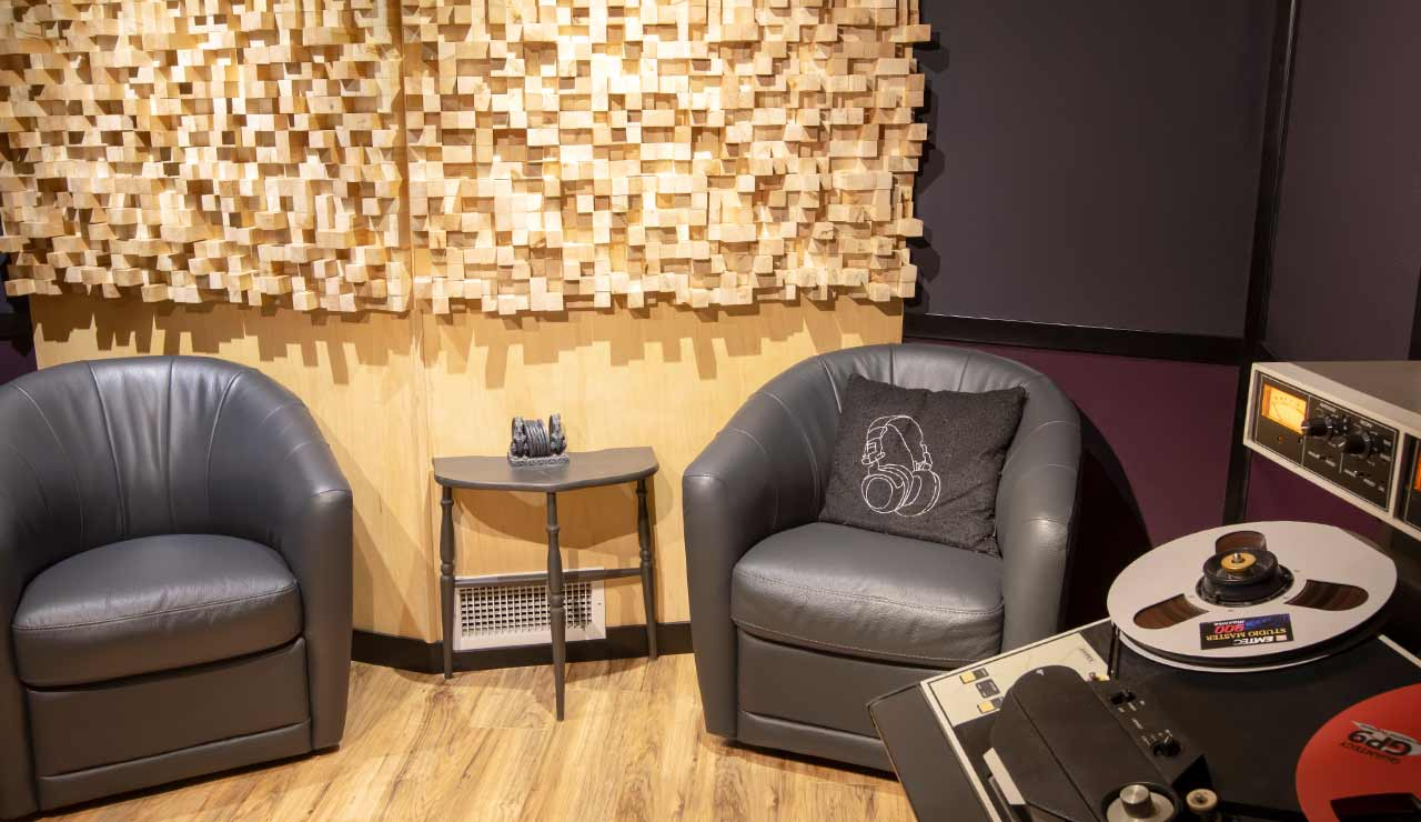 Client area featuring custom diffusers and Ampex ATR-102 analog tape machine