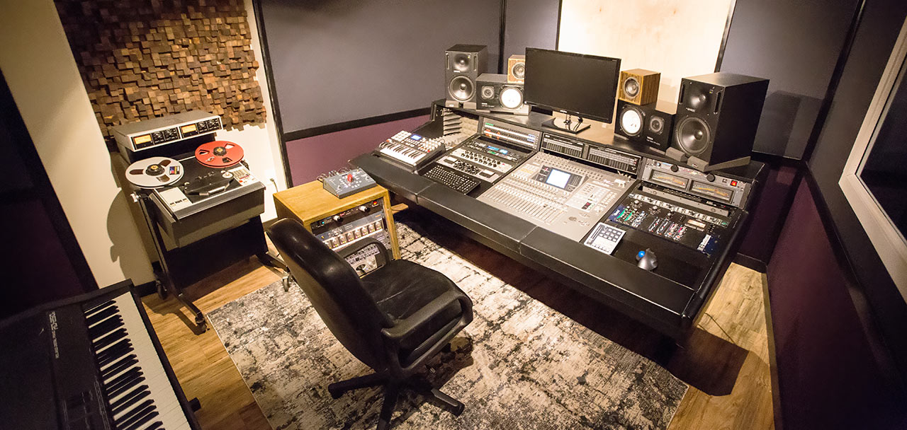 Our control room, featuring our Yamaha O2R mixing console, Ampex ATR-102 tape deck, and custom diffuser. See our Equipment list below.